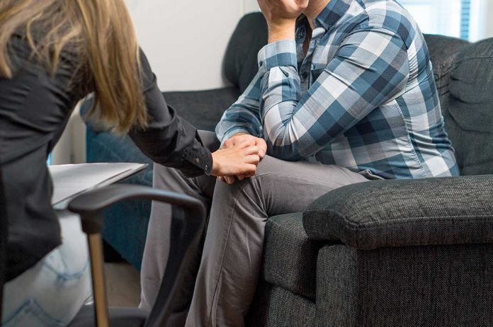A counsellor having a session with a man on