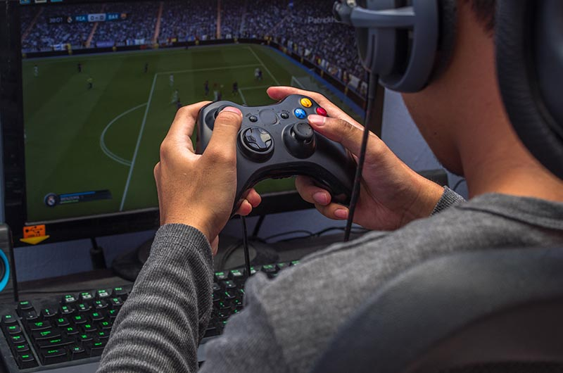 A gamer playing FIFA | iTMunch