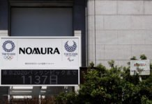Nomura Holdings logo - It will conduct research quantum computing I iTMunch