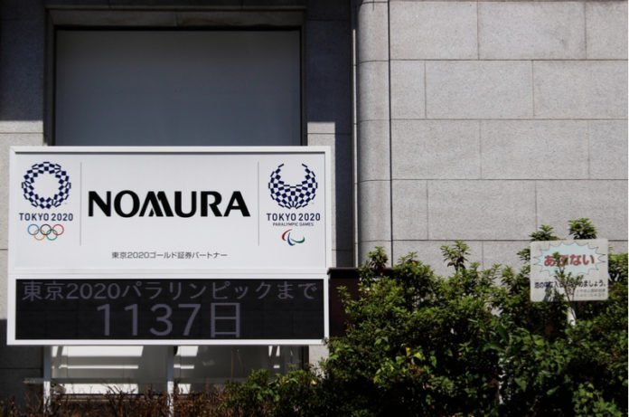 Nomura Holdings logo - It will conduct research quantum computing I iTMunch