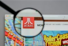Game maker Atari logo highlighted through handlens I iTMunch