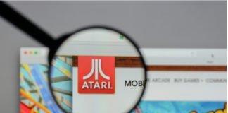 Game maker Atari logo highlighted through handlens I iTMunch