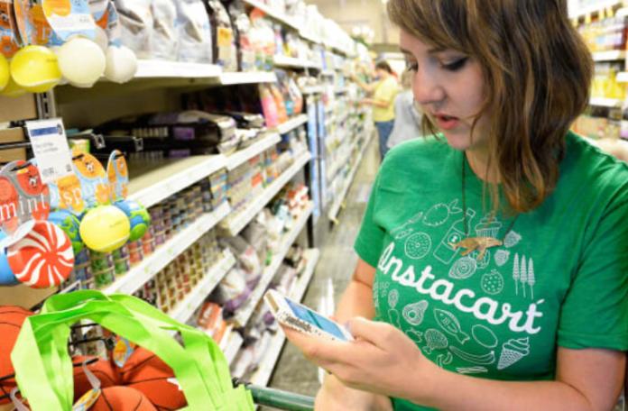A girl wearing instacart top and shoping I iTMunch