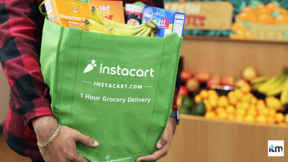 A person holding Instacart grocery bag | iTMunch