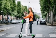 Teenagers driving e-scooter | iTMunch