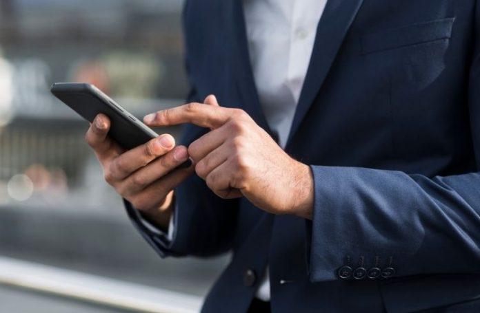 man using smartphone | iTMunch