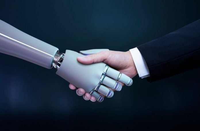 A robot and a human shaking hands