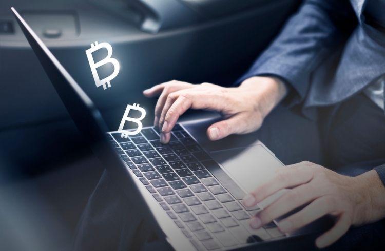 Bitcoin transaction on a laptop